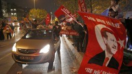 Supporters of Turkish President Erdogan celebrate as preliminary results of the constitutional referendum are announced in Istanbul, Turkey, 16 April 2017. EPA/DENIZ TOPRAK