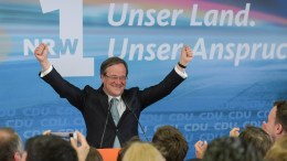 Armin Laschet, regional leader of the Christian Democratic Union (CDU) party, celebrates with supporters of Christian Democartic Union (CDU) after the publication of the first prognosis of the election in German federal state North Rhine-Westpahlia in Duesseldorf, Germany, 14 May 2017. EPA, JOERG SCHUELER