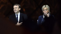French president-elect Emmanuel Macron (L) and his wife Brigitte Trogneux celebrate on stage after winning the second round of the French presidential elections at the Carrousel du Louvre in Paris, France. EPA, JULIEN DE ROSA