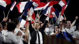 French presidential election candidate from the centrist 'En Marche!' (Onward!) political party, Emmanuel Macron (C) gesturing toward the audience after making his speech, during his political campaign rally at the AccorHotels Arena, in Paris, France. EPA, YOAN VALAT