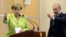 File Photo: Russian President Vladimir Putin (L) and German Chancellor Angela Merkel. EPA, YURI KOCHETKOV