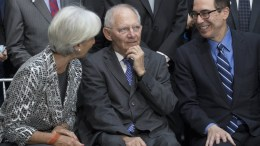 File Photo: German Finance Minister Wolfgang Schauble (C) speaks with Managing Director of the International Monetary Fund (IMF) Christine Lagarde (L) and US Treasury Secretary Steven Mnuchin (R) at the IMF headquarters in Washington, DC, USA. EPA, MICHAEL REYNOLDS