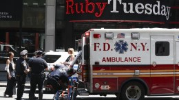 Emergency workers help an injured woman after multiple pedestrians were struck by a vehicle in Times Square in New York, New York, USA. Reports indicated that the vehicle was possibly speeding when it drove up onto the sidewalk striking the pedestrians. EPA/JUSTIN LANE