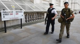 A British Army soldier (R) on guard nearby Whitehall  in London.  EPA/FACUNDO ARRIZABALAGA