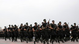 FILE PHOTO. Members of the Palestinian Hamas security forces march in Gaza City. EPA/MOHAMMED SABER