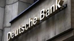 View of the logo of the Deutsche Bank in one of its branches in Berlin, Germany. EPA/FELIPE TRUEBA
