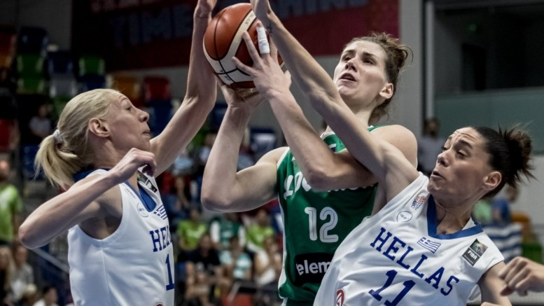 Aikaterina Sotiriou (L) and Angeliki Nikolopoulou (R) of Greece in action against Eva Lisec (C) of Slovenia during the group stage match between Greece and Slovenia at the EuroBasket Women 2017 in Prague, Czech Republic, 17 June 2017. EPA, MARTIN DIVISEK