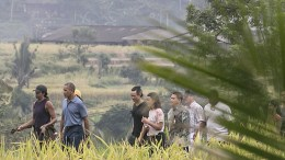 FILE PHOTO: Former US president Barack Obama (2-L) and former first lady Michelle Obama (L) walk at Jatiluwih rice terrace, one of UNESCO World Heritages, during his family holiday in Bali, Indonesia, 25 June 2017. Obama is in Bali as part of his 10 day family holiday in Indonesia. EPA, CHRIS JR