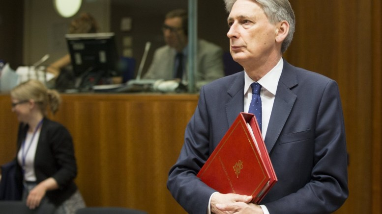 British Chancellor of the Exchequer Philip Hammond looks on during the European Finance Ministers Council meeting in Brussels, Belgium. EPA/OLIVIER HOSLET.