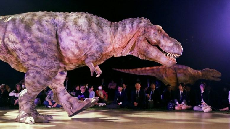 "FILE PHOTO. Dinosaurs walk past visitors during Dinosaur Live show of ""Dino Safari"" in Tokyo, Japan. EPA/KIMIMASA MAYAMA"