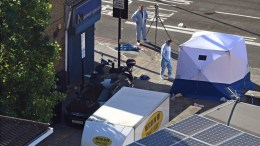 British forensic experts stand next to the van and a forensic tent in Finsbury Park, after a van hit worshippers in north London. EPA/FACUNDO ARRIZABALAGA.