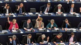 FILE PHOTO. A general view shows members of the European Parliament voting. EPA/PATRICK SEEGER