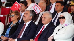 File Photo: Turkish Prime Minister Binali Yildirim (2-R) and Turkish Cypriot leader Mustafa Akinci (2-L) attend a military parade in the Turkish occupied area of Nicosia, Cyprus, 20 July 2017. EPA, ANDREAS MANOLI