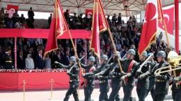 File Photo: Turkish Prime Minister Binali Yildirim and Turkish Cypriot leader Mustafa Akinci attend a military parade in the Turkish occupied area of Nicosia, Cyprus, 20 July 2017. EPA, ANDREAS MANOLI
