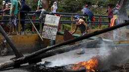 Protesters build a burning barricade during a demonstration in Barquisimeto, Venezuela. EPA, PASQUALE GIORGIO