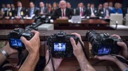 File Photo: News photographers take pictures as former CIA Director John Brennan testifies before the House Intelligence Committee hearing on the investigation about Russian interference in the 2016 presidential campaign on Capitol Hill in Washington, DC, USA. EPA, SHAWN THEW