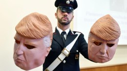 Masks of US President Donald J. Trump used by two alleged thieves are displayed by Italian Carabinieri police during a press conference in Turin, northern Italy, 24 July 2017. Two brothers, Vittorio and Ivan Lafore, used the masks to disguise themselves as they allegedly attempted to break into ATM cash machines. The brothers were arrested on 24 July 2017 in Turin. EPA, ALESSANDRO DI MARCO