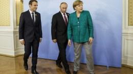German Chancellor Angela Merkel, Russian President Vladimir Putin and French President, Emmanuel Macron, meet during the G20 leaders summit at the Hotel Atlantic, in Hamburg, Germany. EPA/MORRIS MACMATZEN / POOL