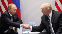 FILE PHOTO. Russian President Vladimir Putin and US President Donald J. Trump shake hands during a meeting on the sidelines of the G20 summit in Hamburg. The G20 Summit (or G-20 or Group of Twenty) is an international forum for governments from 20 major economies. The summit is taking place in Hamburg from 07 to 08 July 2017. EPA/MICHAEL KLIMENTYEV / SPUTNIK / KREMLIN POOL / POOL MANDATORY CREDIT