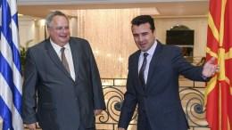 File Photo: Greek Minister of Foreign Affairs Nikos Kotzias (L) and the Fyromiana Prime Minister Zoran Zaev (R) at the Government building in Skopje, FYROM, 31 August 2017. EPA, GEORGI LICOVSKI / POOL