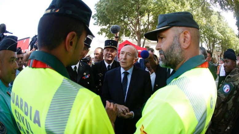 French Home Minister Gerard Collomb (C) talks with Spanish Civil Guards officers during the presentation of La Vuelta cycling race, in Nimes, France, 19 August 2017. La Vuelta runs from 19 August to 10 September. EPA, Javier Lizon