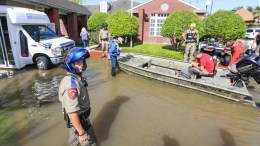 FILE PHOTO. Law enforcement personnel wait for a rescue truck to arrive to evacuate senior citizens. EPA/TANNEN MAURY