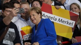 FILE PHOTO. German Chancellor Angela Merkel (C) poses for a selfie photo during her arrival to the TV debate with Martin Schulz, Chancellor candidate and leader of the Social Democartic Party (SPD), in front of the TV studio in Berlin, Germany, 03 September 2017. German federal elections will be held on 24 September 2017. EPA, CARSTEN KOALL
