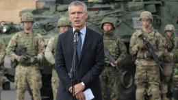 North Atlantic Treaty Organization (NATO) Secretary General Jens Stoltenberg (C) with soldiers of the Batallion Battle Group NATO. EPA/TOMASZ WASZCZUK POLAND OUT
