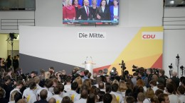 File Photo: Supporters of CDU watch the speech of Martin Schulz, leader of the Social Democratic Party (SPD) and top candidate for Chancellor, at the CDU election event in Berlin, Germany, 24 September 2017. EPA, CLEMENS BILAN