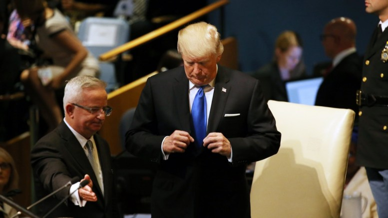 US President Donald J. Trump adjusts his suit before addressing the audience during the opening of the General Debate of the 72nd United Nations General Assembly at at UN headquarters in New York, New York, USA, 19 September 2017. EPA, PETER FOLEY