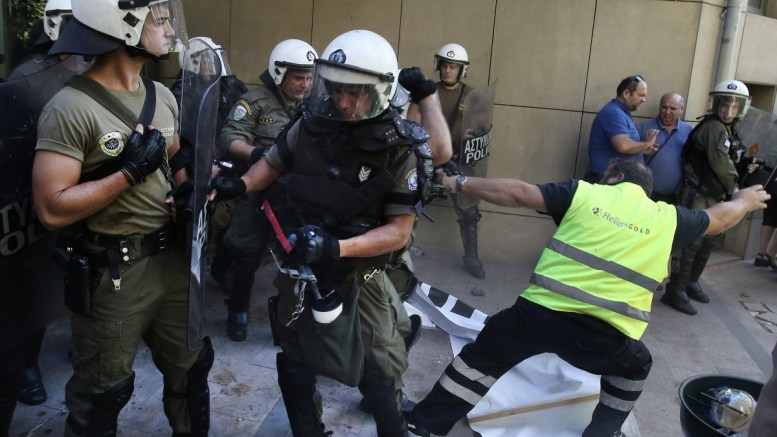 Miners of a gold mine in northern Greece clash with riot police during a protest against the suspension of Eldorado's investment in Greece, outside of the Environment ministry, in Athens, Greece, 13 September 2017. Canadian gold mining company Eldorado Gold recently announced it would be suspending its operations in Greece, citing the failure of the Greek government to meet its contractual obligation. Some of the protesters managed to break the police lines and entered the building. EPA/SIMELA PANTZARTZI