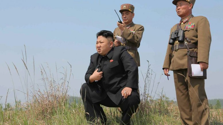 An undated handout picture released by North Korean newspaper of the Central Committee of the Workers' Party of Korea, Rodong Sinmun, shows North Korean leader Kim Jong-un (L) observing a firing drill. EPA, RODONG SINMUN -- BEST QUALITY AVAILABLE -- SOUTH KOREA OUT HANDOUT EDITORIAL USE ONLY, NO SALES