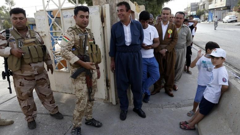 FILE PHOTO. Iraqi Kurd voters queue outside a polling station during Kurdistan independence referendum in Erbil, Kurdistan region. EPA, MOHAMED MESSARA