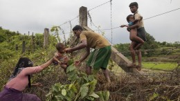 FILE PHOTO. A Rohingya Muslim family crosses a fence as they enter Bangladesh near the Bangladesh-Myanmar border in Teknaf, Bangladesh, 04 September 2017. At least 87,000 members of the Rohingya Muslim minority have entered Bangladesh in the last week fleeing violence in northwestern Myanmar, a United Nations official said on 04 September 2017. EPA/STR