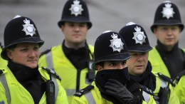 File Photo: Police are given a briefing in London. APE