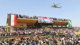 File PHOTO: Crowds of mourners wave for the helicopter carrying the body of Major General Issam Zahreddine, a prominent Syrian general known for his fight against IS and who was killed on 18 October, at the National Stadium Square in the southern province of al-Sweida, Syria, 20 October 2017. The general was killed on the battlefield in Syria's northeastern province of Deir Ezzor after his convoy struck a land mine planted by the Islamic State (IS). Zahreddine, 56, was the commander of the elite 104th Airborne Brigade of the Republican Guard that fought off IS for several years, while under siege and under supplied. EPA, STR