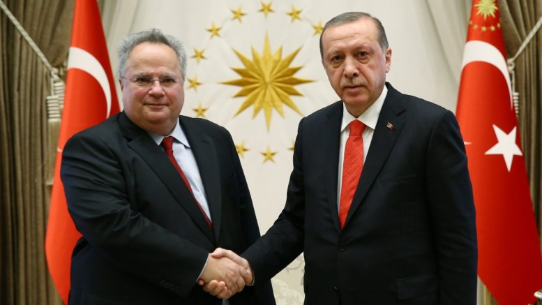 A handout photo made available by the Turkish President Press office shows, Greek Foreign Minister Nikos Kotzias (L) shaking hands with Turkish President Recep Tayyip Erdogan (R) in Ankara, Turkey, 24 October 2017.  EPA, TURKISH PRESIDENT OFFICE HANDOUT, EDITORIAL USE ONLY