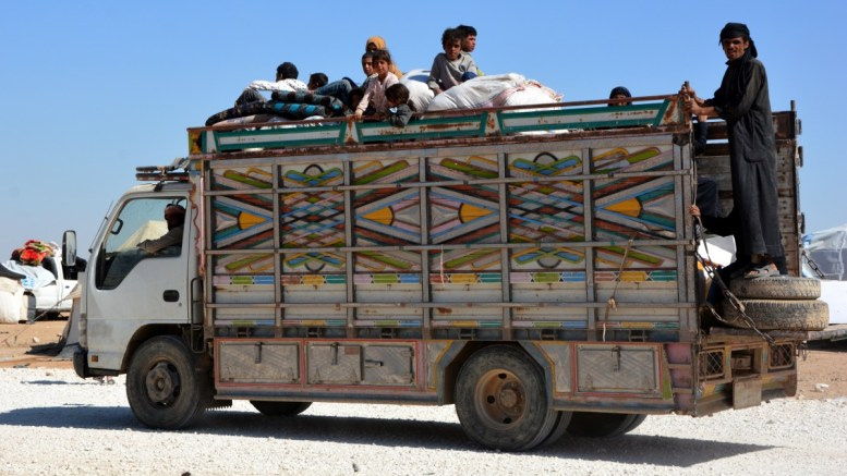 FILE PHOTO: Displaced Syrian families who fled from Deir Ezzor. EPA, YOUSSEF RABIH YOUSSEF
