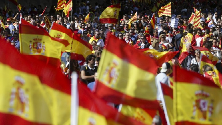 FILE PHOTO. People with Spanish and Catalan flags gather for a rally called by the 'Societat Civil Catalana' (Civil Catalan Society) in downtown Barcelona, Spain. EPA/JOSE COELHO