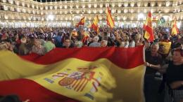 FILE PHOTO. Thousands gather at the Plaza Mayor with Spanish national flags to support Spanish Security Forces deployed in Catalonia. EPA, JM GARCIA