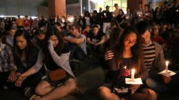 Student mourners console each other during a candlelight vigil at the University of Nevada Las Vegas (UNLV) for victims of a mass shooting in Las Vegas, Nevada, USA, 02 October 2017. Police reports indicate that a gunman, identified as Stephen Paddock, 64, firing from an upper floor of the Mandalay Bay hotel killed at least 58 people and injured more than 500 before he reportedly killed himself as police made their way to his hotel room. EPA/EUGENE GARCIA