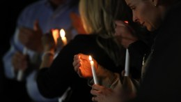People light candles during a candlelight vigil for all those affected by the mass shooting at the Route 91 Harvest Festival on Las Vegas Boulevard at Mountain Crest Park in Las Vegas, Nevada, USA, 03 October 2017. EPA/PAUL BUCK