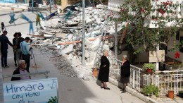 People look on debris of demolished house in Himara, Albania, 01 November 2017. The municipality of Himara decided to knock down houses belonging to Greek minority citizens in the centre of the city and tensions between citizens and authorities are increasing. Families were given a five-day notice on 18 October, to evacuate their homes, which are slated for demolition as part of an urban regeneration plan that critics have denounced as unconstitutional. EPA, MALTON DIBRA