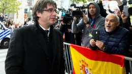 FILE PHOTO. Dismissed Catalonian regional President Carles Puigdemont (L) arrives at the press club ahead of his press conference at the Press Club in Brussels, Belgium, 31 October 2017. EPA/STEPHANIE LECOCQ