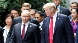 FILE PHOTO. US President Donald J. Trump and Russia's President Vladimir Putin. EPA/JORGE SILVA / POOL