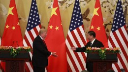 A file picture released by Xinhua News Agency shows US President Donald J. Trump (L) shake hands with his Chinese counterpart Xi Jinping (R) at a press conference. EPA, XINHUA EDITORIAL USE ONLY/NO SALES