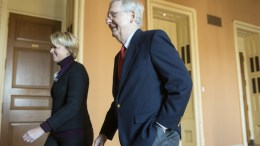 Senate Majority Leader Republican Mitch McConnell (R) and his operations director Stefanie Hagar Muchow (L) walk from his office to the Senate chamber on Capitol Hill in Washington, DC, USA, 01 December 2017. The Senate is expected to vote this week on a Republican-crafted tax plan.  EPA/MICHAEL REYNOLDS