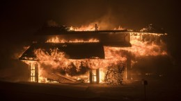 A home burns during the 'Thomas Fire' which began overnight  in Ventura, California, USA, 05 December 2017. In the first 10 hours, the fire has already burned 31,000 acres (12,545 hectares) and has forced more than 25,000 people to evacuate as one of the strongest Santa Ana winds forecast of the season is ongoing and expected to last several days.  EPA/JOHN CETRINO