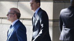 Former National Security Advisor Michael Flynn (C) exits the E. Barrett Prettyman Federal Courthouse in Washington, DC, USA, 01 December 2017. Flynn pleaded guilty to lying to the FBI regarding conversations with the Russian ambassador during the presidential transition in 2016.  EPA/MICHAEL REYNOLDS