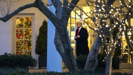 File Photo: US President Donald Trump walks out of the Oval Office of the White House. Washington, DC. EPA, JIM LO SCALZO